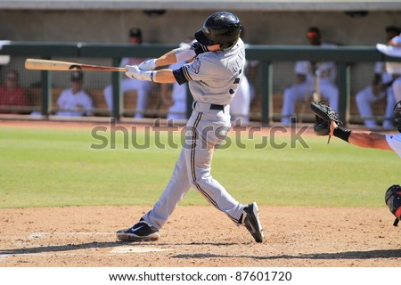 PHOENIX, AZ - OCTOBER 19: Milwaukee Brewers prospect Scooter Gennett bats for the Peoria Javelinas in the Arizona Fall League Oct. 19, 2011 at Phoenix Municipal Stadium in Phoenix, AZ. Gennett went 3-for-4. - stock photo
