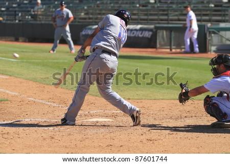 PHOENIX, AZ - OCTOBER 19: New York Mets prospect Jefry Marte bats for the Peoria Javelinas in the Arizona Fall League Oct. 19, 2011 at Phoenix Municipal Stadium in Phoenix, AZ. Marte homered, doubled, and walked. - stock photo