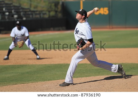 PHOENIX, AZ - OCTOBER 19: New York Yankees Triple-A prospect David Phelps pitches for the Phoenix Desert Dogs in an Arizona Fall League game Oct. 19, 2011 at Phoenix Municipal Stadium, Phoenix, AZ. - stock photo