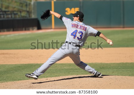 PHOENIX, AZ - OCTOBER 19: Taylor Whitenton, a New York Mets prospect, delivers a pitch in the Arizona Fall League on Oct. 19, 2011 at Phoenix Municipal Stadium, Phoenix, AZ. Whitenton allowed one run in two innings. - stock photo