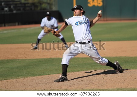 PHOENIX, AZ - OCTOBER 19: Toronto Blue Jays Double-A prospect Evan Crawford pitches for the Phoenix Desert Dogs in an Arizona Fall League game Oct. 19, 2011 at Phoenix Municipal Stadium, Phoenix, AZ.