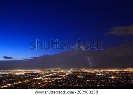 Phoenix city lights at dusk with a lightning strike - stock photo