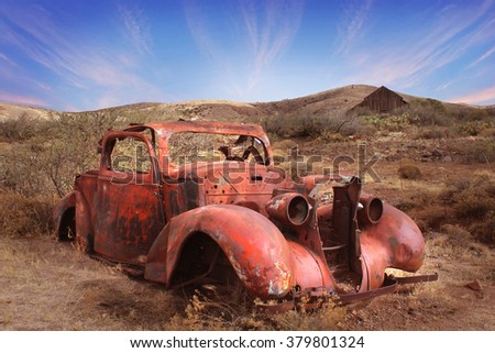 PHOENIX - FEB 19: Old car in the desert on the outskirts of Phoenix, Arizona on February 19, 2016. - stock photo