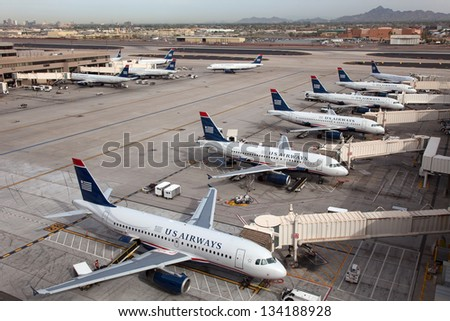PHOENIX - MARCH 20: Morning rush of US Airways aircraft on March 20, 2013 in Phoenix. US Airways is a major U.S. airline, headquartered in Tempe, Arizona. It carried 51 million passengers in 2009. - stock photo