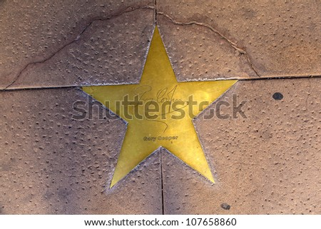 PHOENIX, USA - JUNE 14: star of Gary Cooper in copper reflect the past glory of the Hotel San Carlos on June 14,2012 in Phoenix, USA. The stars in the sidewalk were put in 1993 due to their visits.