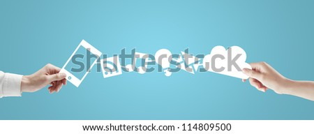 phone and cloud in hands on a blue background - stock photo