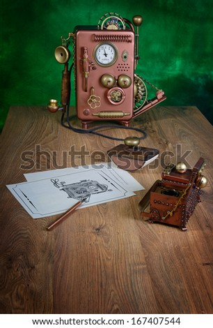 Phone and drawing on a wooden table. Style Steampunk. - stock photo