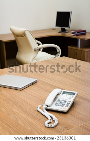 Phone and laptop on a table at modern office