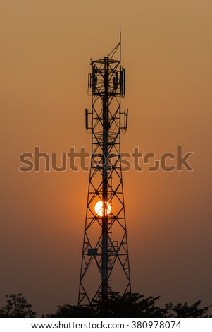 Phone Antenna Tower with a sunset in the background. Thailand  -  Silhouette-Evening light  - stock photo