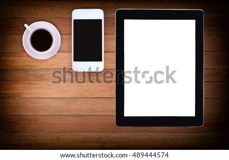 phone, blank note paper, pencil and coffee cup on wood desk top view. empty space for text. selective focus.