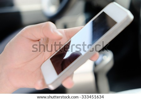 phone call in the car. - stock photo
