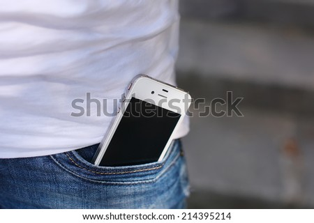 phone in jeans pocket - stock photo