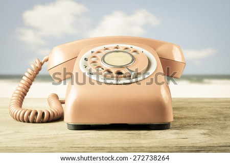 Phone vintage on sea background , retro style