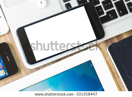 Phone with blanck screen on keyboard of laptop