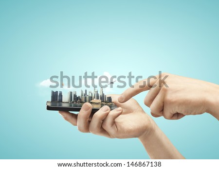 phone with model city in hands - stock photo