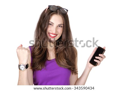 Phone  woman winning happy excited looking on camera isolated on white background. Joyful fresh and energetic Caucasian young woman.