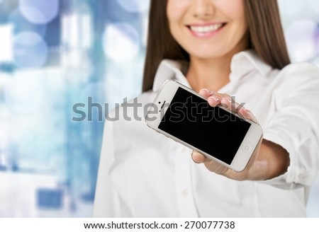 Phone. Young woman show display of mobile cell phone with black screen and smiling on a white background. Focus on hand with mobile phone - stock photo
