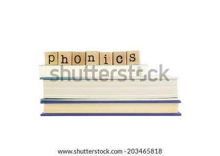 phonics word on wood stamps stack on books,  language and reading concepts - stock photo