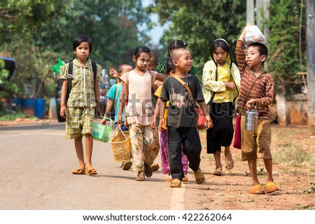 PHOP PHRA, TAK,  THAILAND - MAY 17, 2016 : Children of migrant workers are comming back home after learning at the Non-formal Education Ban Ruamthai Patthana, Phop Phra, Tak, Thailand.