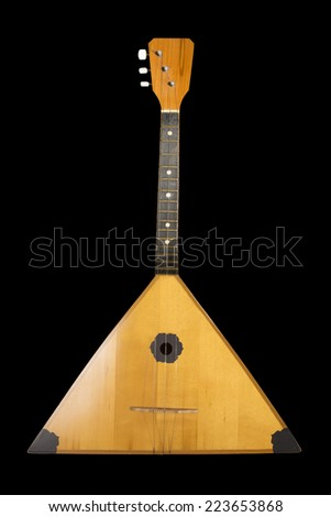photo a musical instrument a balalaika on black background - stock photo