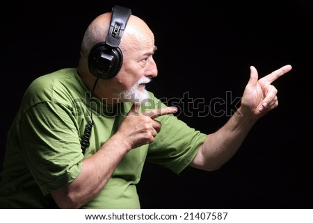 photo  a senior with headphones listening music - stock photo