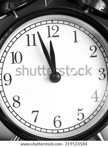Photo alarm clock,arrow close to 12 hours - stock photo