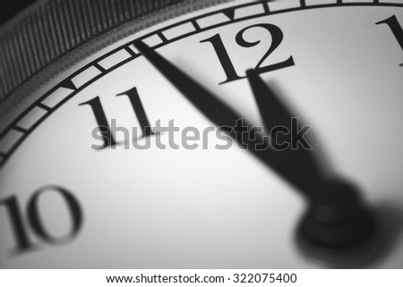 Photo alarm clock, arrow close to 12 hours - stock photo