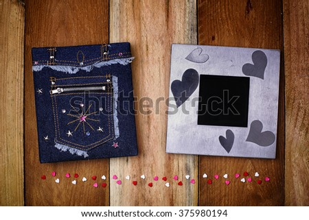 Photo album and photo frame on wood backgrounds with small hearts - stock photo
