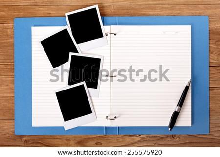 Photo album, polaroid photo frames.   - stock photo