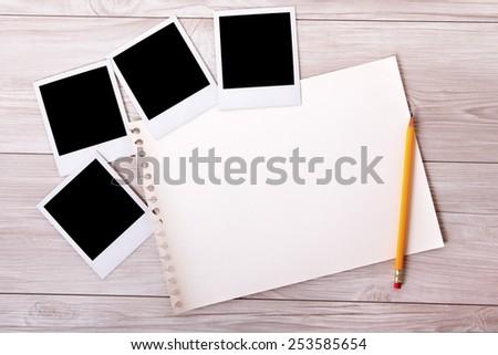 Photo album : torn page, blank polaroid photo prints.   - stock photo