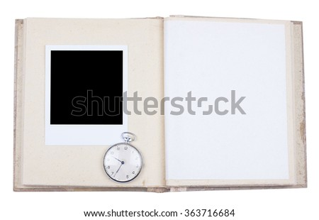 Photo album with photo frame and old pocket watch - stock photo