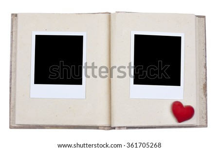 Photo album with photo frame and red heart - stock photo