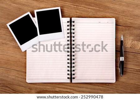 Photo album with two blank polaroid style instant photo prints.  Space for copy.   - stock photo