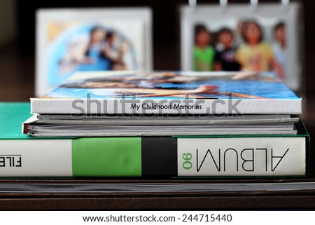 Photo Albums, Photo Books and Childhood Memory Photos on Wooden Desk - stock photo