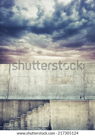 Photo background with concrete stairway and dark cloudy sky - stock photo