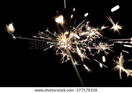 Photo Bengal fire close-up. Bright lights sparkler. - stock photo