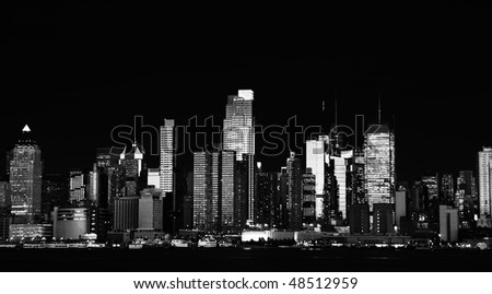 photo black and white new york city skyline cityscape from midtown manhattan at night. epic  beautiful b&w new york cityscape over the hudson river.