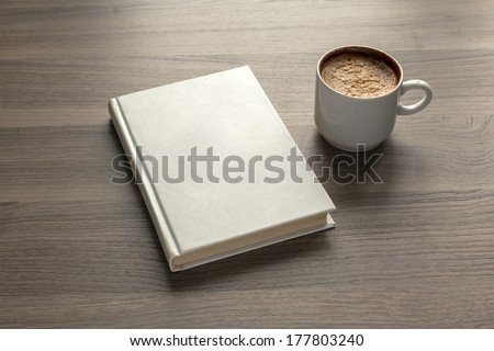 Photo blank book cover on textured wood background with cape of coffee - stock photo