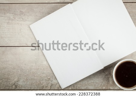Photo blank. Open book,  brochure on a wooden table and coffee  - stock photo
