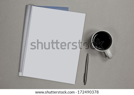 Photo. Blank open magazine isolated on textured background with pen and cup of coffee - stock photo