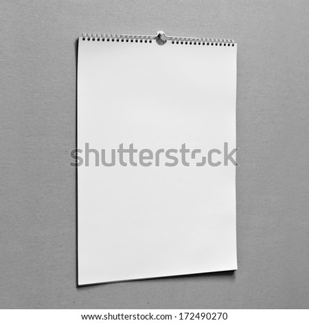 Photo. Blank wall calendar with spring on a texture background. Side view - stock photo