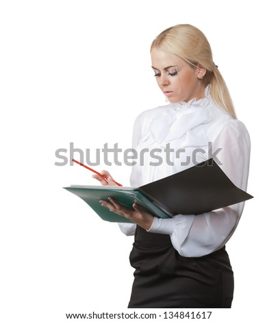 photo blond girl in a business suit holding a green folder and red pencil