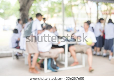 photo blur of student activity in classroom - stock photo
