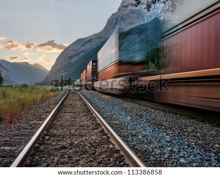 Photo blurred intentionally to show the motion of the train. - stock photo