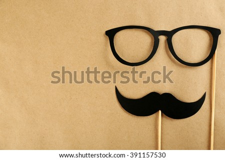 Photo booth props glasses, mustache on beige background