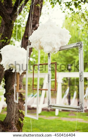 photo booth with frames and clouds - stock photo