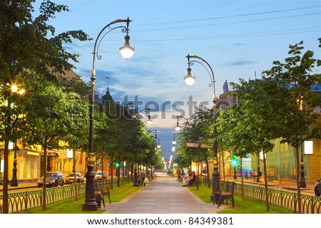 photo brightly lit alley in the city - stock photo