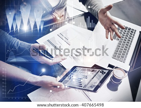 Photo business team brainstorming.Finance department managers working new global project in office.Using electronic devices.Graphics icons,worldwide stock exchanges interface on the screen. Horizontal - stock photo