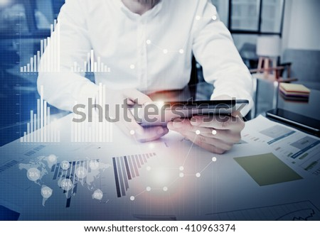 Photo businessman touching modern tablet screen.Trader manager working new private banking project office.Using electronic device.Graphics icons,worldwide stock exchanges interface.Bokeh,film effect - stock photo