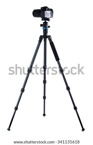 Photo camera on tripod isolated over white background - stock photo